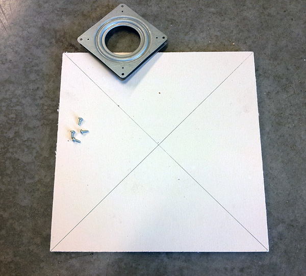 "Use a straight edge to mark lines from one corner of the board to the other resulting in an ""X."""